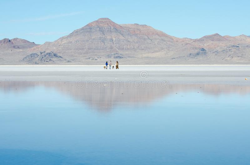 Mountains and sky reflected in Bonneville Salt Flats. Utah. US royalty free stock image