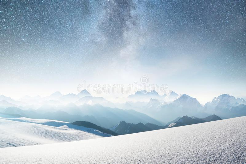 Mountains and sky with stars. Natural landscape in mountains region at the winter time. Starry sky and high peak stock image