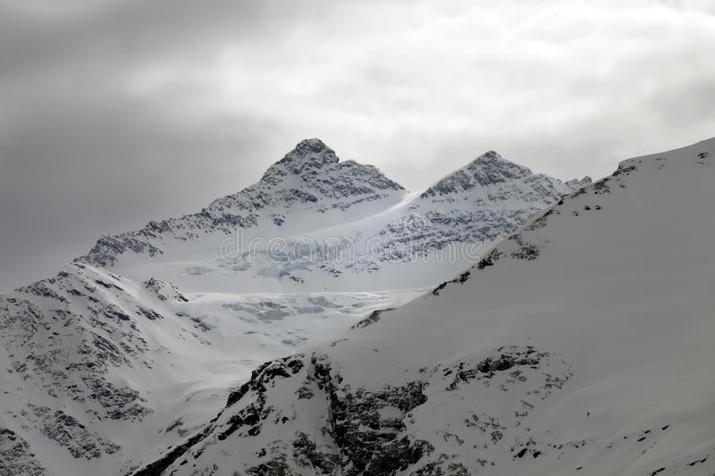 Mountains in snow in cloudy weather. Elbrus. Russia. Caucasus royalty free stock photos