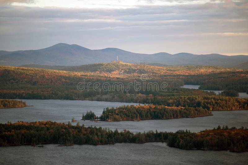 Mountains and Squam Lake in autumn stock photos