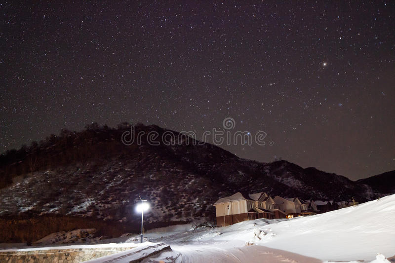 Download Mountains and stars stock photo. Image of dark, winter - 28857494