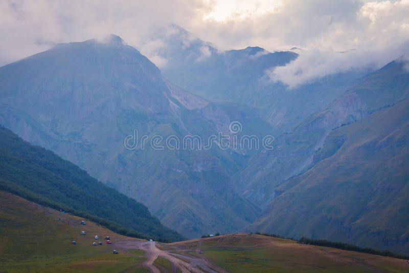 Mountains in summer in Georgia. Mountains in the clouds. Horizontal view. Mountains in summer in Georgia. Mountains in the clouds. Horizontal view stock image