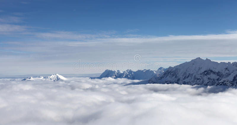 Mountains summits and clouds royalty free stock photography