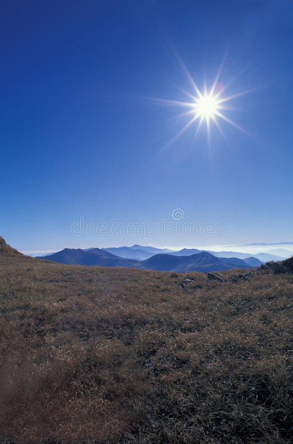 Mountains with sun. Sun over Rodna Mountains, Eastern Carpathians, Romania stock photo