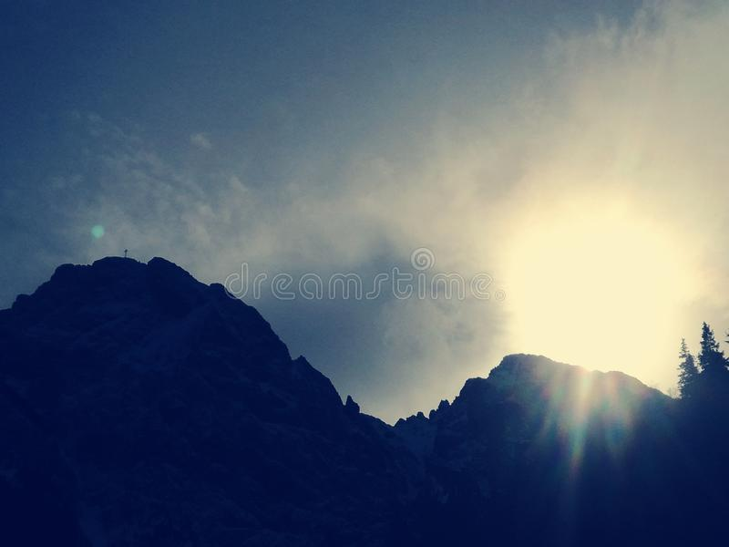 Mountains and a Sun royalty free stock photo