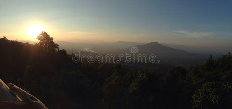 Mountains and sun stock photo
