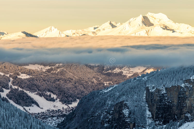 Mountains with a sunrise surrounded stock images