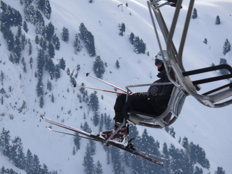 Trentino, Italy. 01/03/2011. Chairlift in the mountains of the Dolomites stock photography