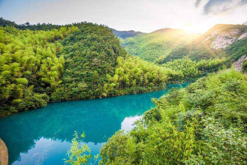 Mountains under the blue lake stock image