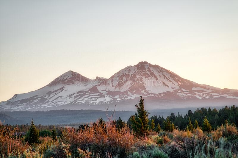 Mountains under the clear late afternoon sky. Mountains outside of Sisters, Oregon under the clear late afternoon sky royalty free stock photo