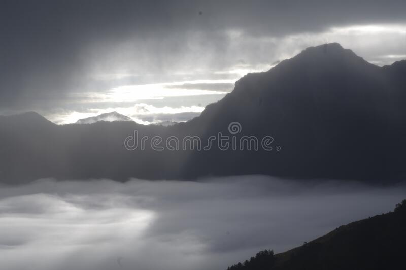Mountains and valley in fog royalty free stock photography