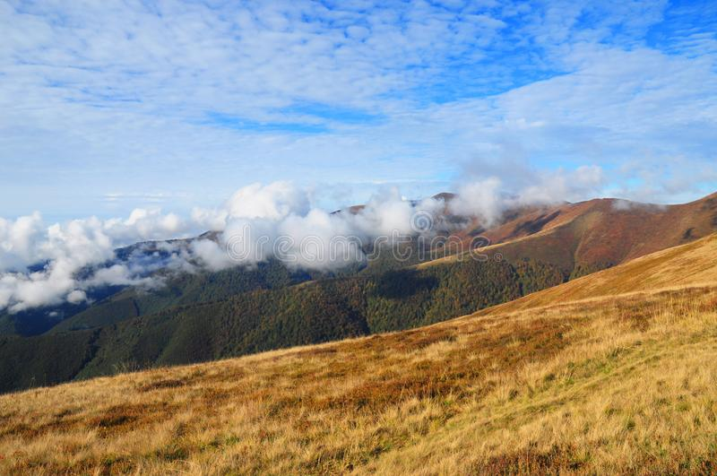 Mountains view. Mountain inspiring landscape with beautiful clouds royalty free stock photo