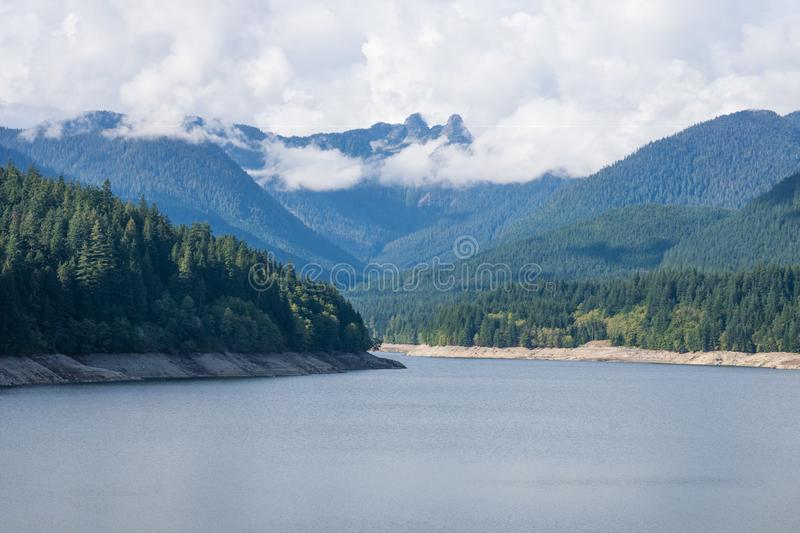 Mountains view near Vancouver lynn canyon and grouse grind, lake shore royalty free stock photos