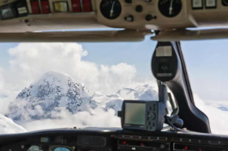 Mountains viewed from cockpit. Scenic view of snow capped peaks of Mount McKinley viewed from aircraft cockpit, Denali National Park, Alaska, U.S.A royalty free stock photos