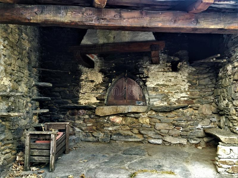 Mountain`s kiln. Mountains, vintage kiln, wood, stones, peace and fireplace stock images