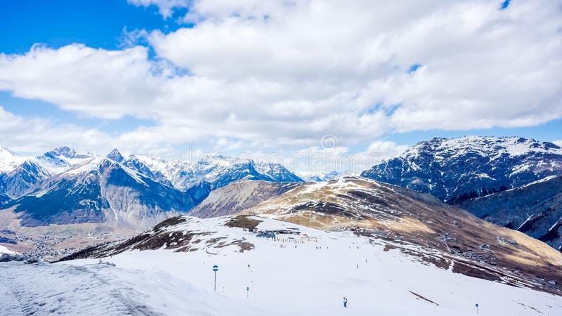 Mountains in winter, slopes and pistes, Livigno village, Italy, Alps. Beautiful mountains in winter, slopes and pistes with ski lifts, ski and snowboard holidays stock images