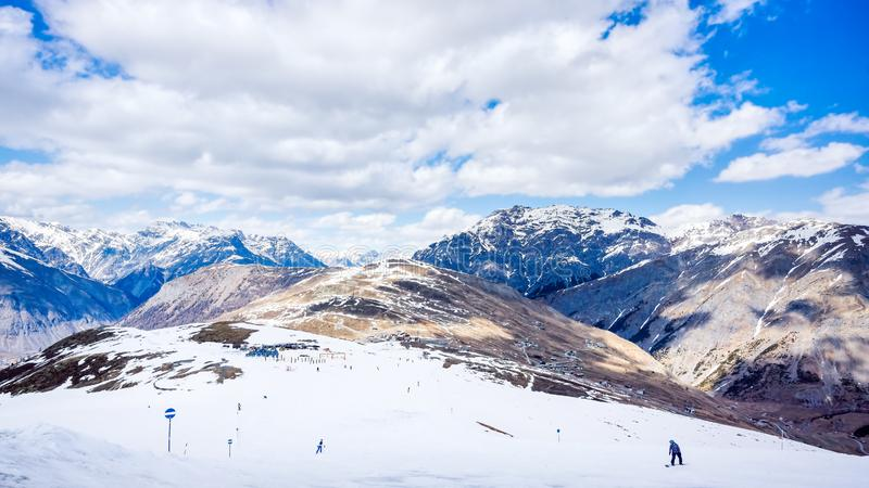 Mountains in winter, slopes and pistes, Livigno village, Italy, Alps. Beautiful mountains in winter, slopes and pistes with ski lifts, ski and snowboard holidays royalty free stock images
