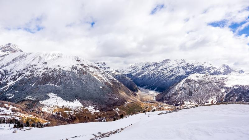 Mountains in winter, slopes and pistes, Livigno village, Italy, Alps. Beautiful mountains in winter, slopes and pistes with ski lifts, ski and snowboard holidays royalty free stock photo