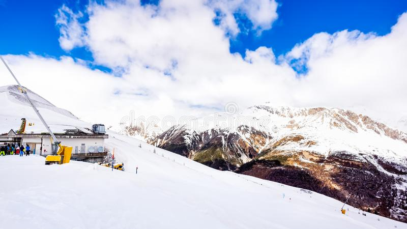 Mountains in winter, slopes and pistes, Livigno village, Italy, Alps. Beautiful mountains in winter, slopes and pistes with ski lifts, ski and snowboard holidays royalty free stock photography