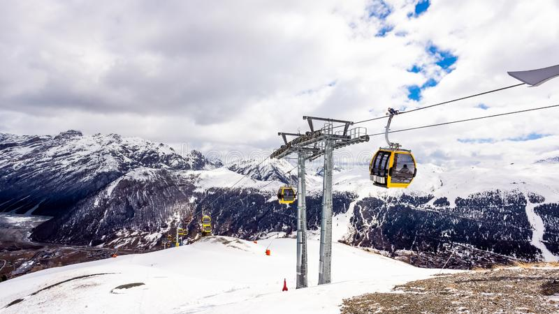 Mountains in winter, slopes and pistes, Livigno village, Italy, Alps. Beautiful mountains in winter, slopes and pistes with ski lifts, ski and snowboard holidays stock image
