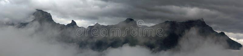 Mountainscape. Mountain range in misty weather stock photos
