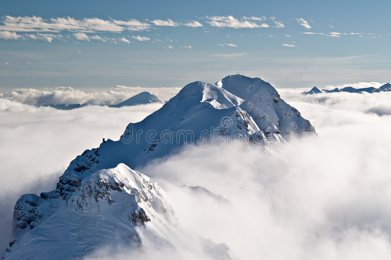 Mountaintop with clouds stock images