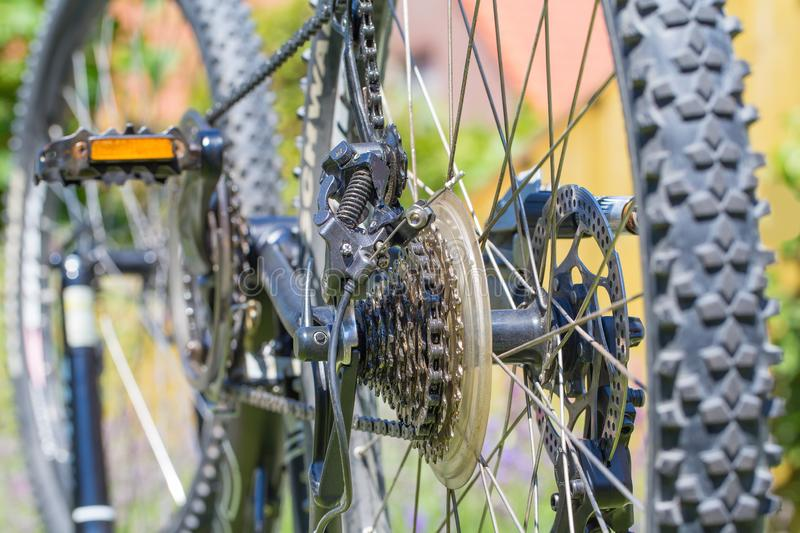 Mountanbike upside down with wheels and gears royalty free stock photography