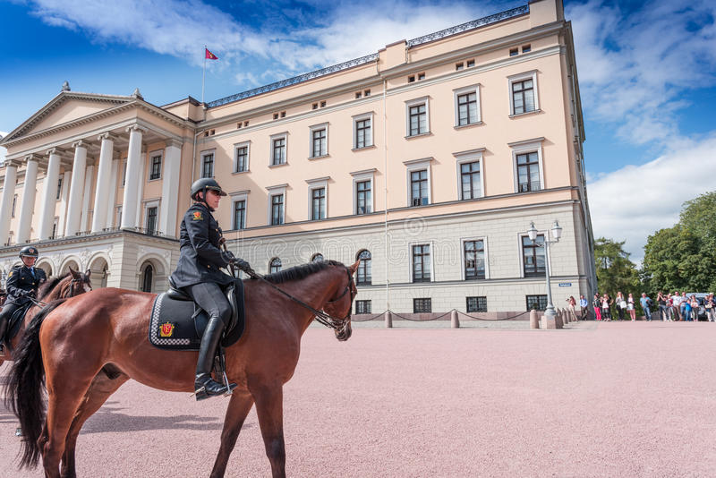Mounted Police near Royal Palace in Oslo. OSLO, NORWAY - AUGUST 28: Mounted Police near Oslo Royal Palace at August 28, 2014. Rytterkorpset (The Mounted Police) royalty free stock photos