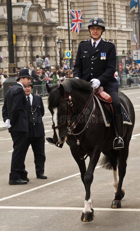 Mounted Police Officer at the Royal Wedding. A mounted police officer in ceremonial uniform at the Royal Wedding, London 2011 stock images