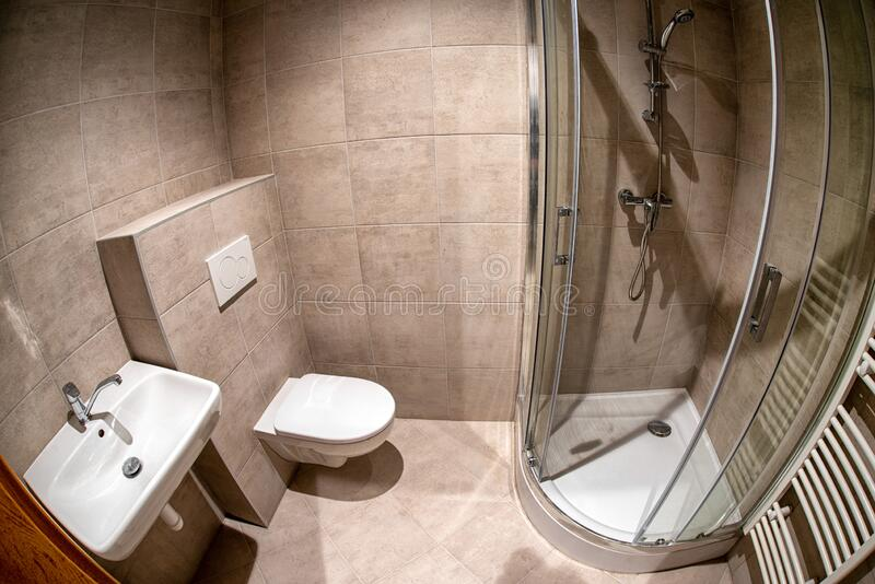 Mounted toilet bowl and shower stock image