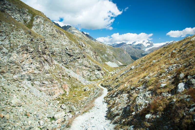 Between mountens. Smaall Path between mountens, Alps, Swiss royalty free stock photography