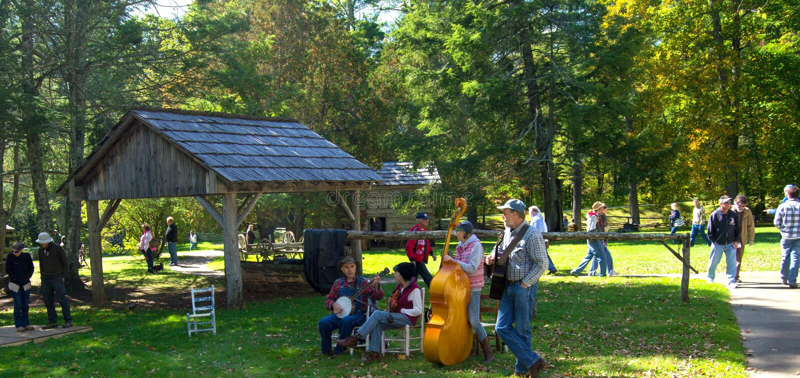 Mountain Music on The Blue Ridge Parkway. Floyd County, VA – October 6, 2014: Musician playing mountain music at Mabry Mill on the Blue Ridge Parkway on stock images