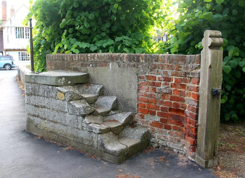 Mounting block and whipping post at Bradwell on sea, Essex. These mounting blocks and cast iron post are Grade II listed. They are adjacent to the south entrance royalty free stock photos