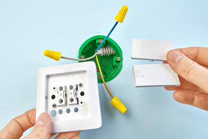 Installation Of Double Light Switch Stock Image - Image of