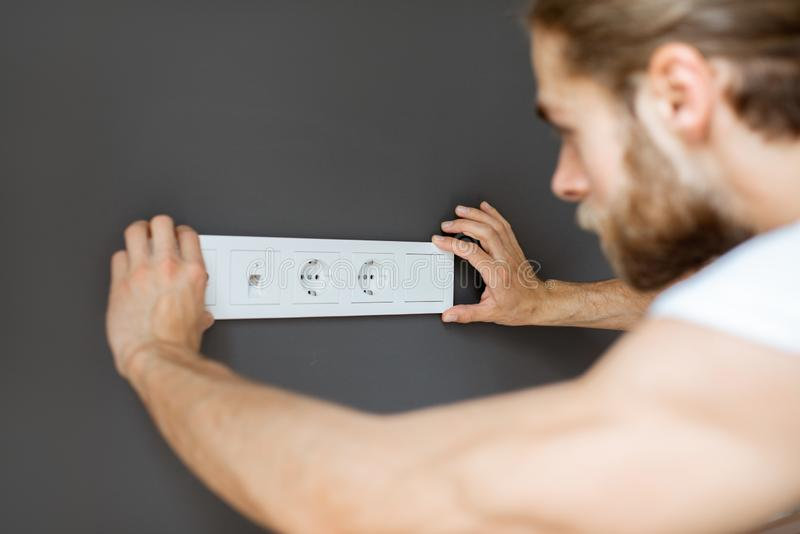 Mounting electric sockets royalty free stock image