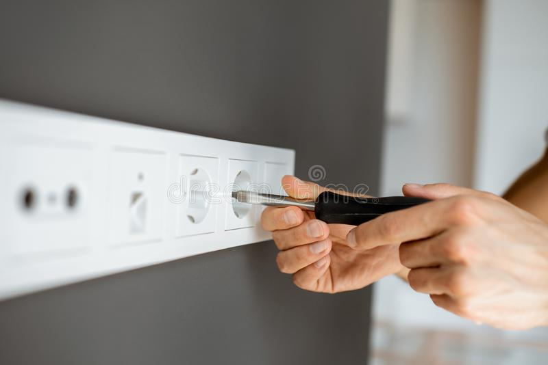 Mounting electric sockets royalty free stock photos