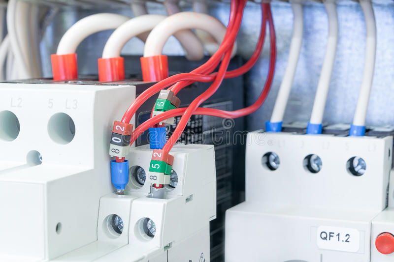 On the mounting panel in the electrical Cabinet there are installed circuit breakers protect the motor. Circuit breakers protect m. Otors connected by wires with royalty free stock photos