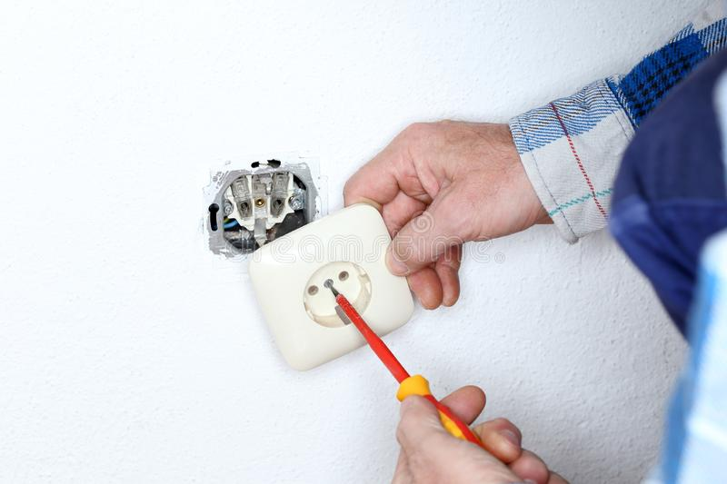Mounting a wall socket stock image