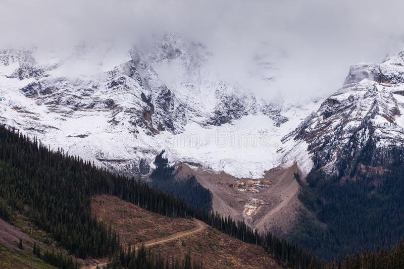 A mountsain in the Canadian Rocky Mountains shrouded in clouds on a cold day royalty free stock photos