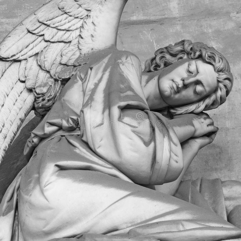 Mourning. Antique angelic headstone, monumental cemetery Staglieno, Genoa, Italy, Europe royalty free stock image
