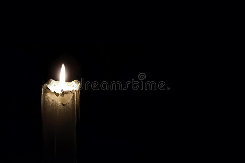 Mourning Glowing Candle on black background.Empty space for text. Mourning Glowing Candle on black background with empty space for text royalty free stock photography