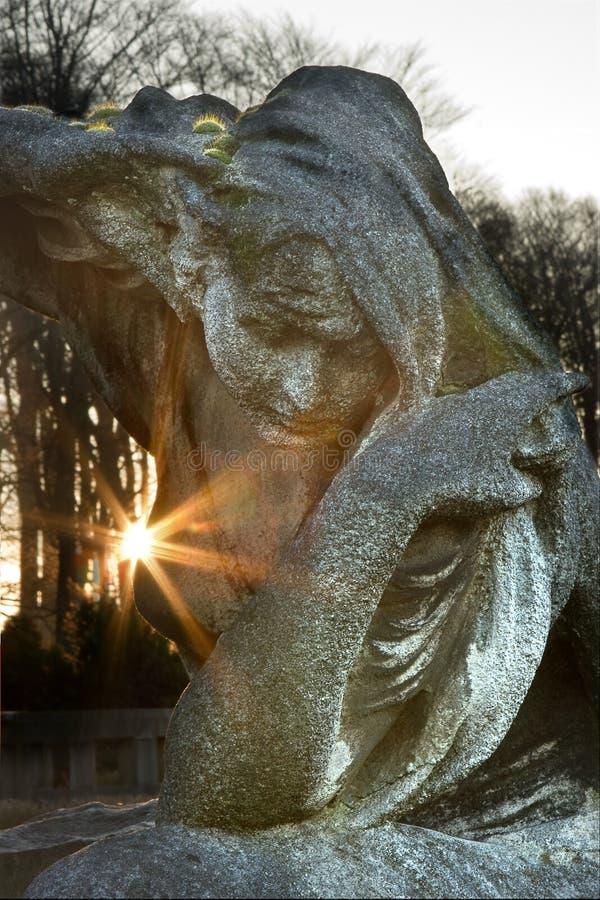 Mourning in granite stock photo