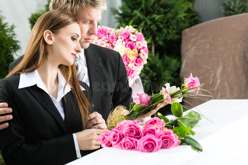 Mourning People at Funeral with coffin stock photography