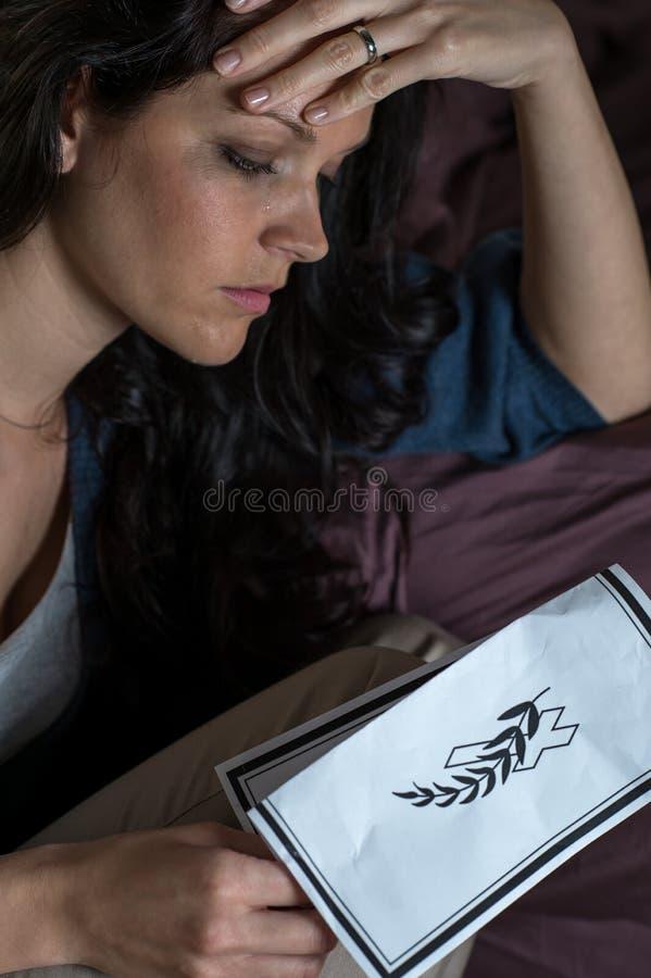 Free Mourning Woman Holding Obituary Royalty Free Stock Image - 34322386