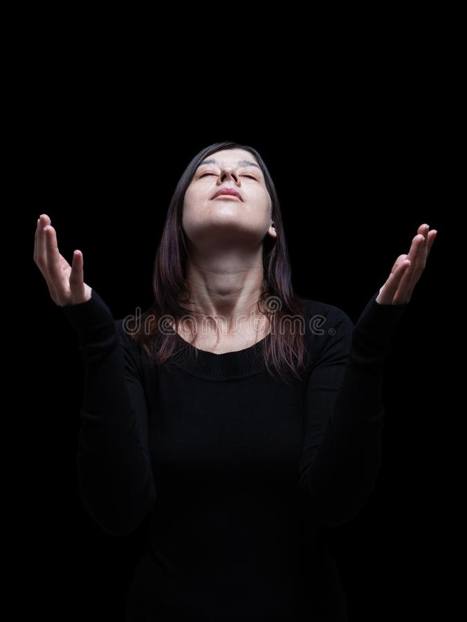 Free Mourning Woman Praying, With Arms Outstretched In Worship To God Stock Photos - 102088823