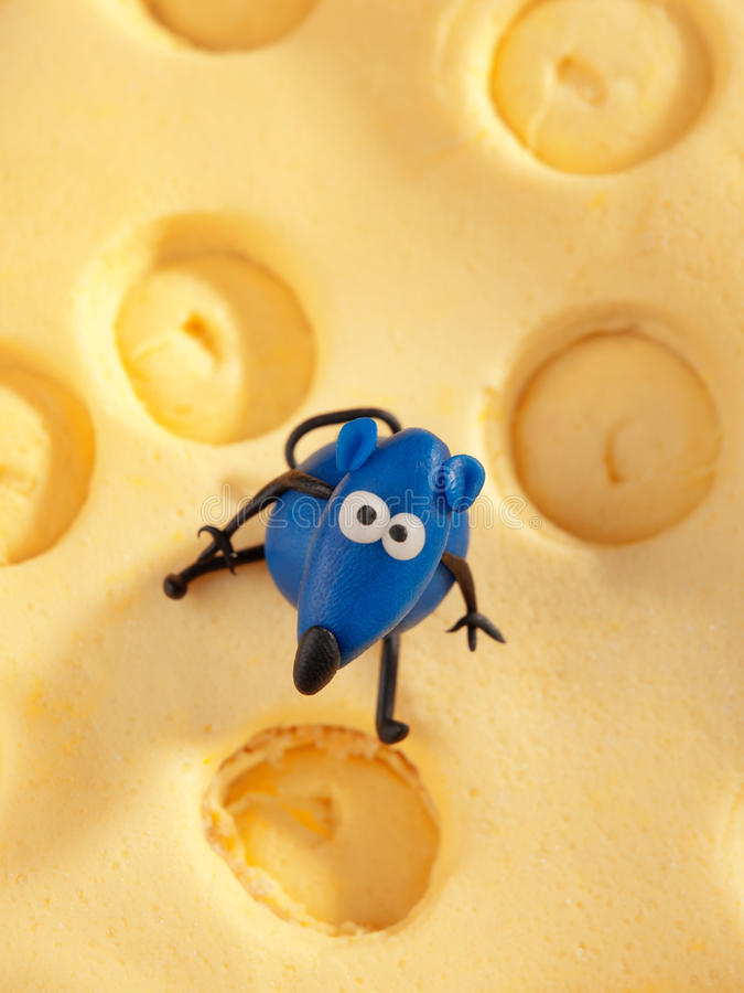 Mouse on cheese fondant cake. Shot from above royalty free stock photography