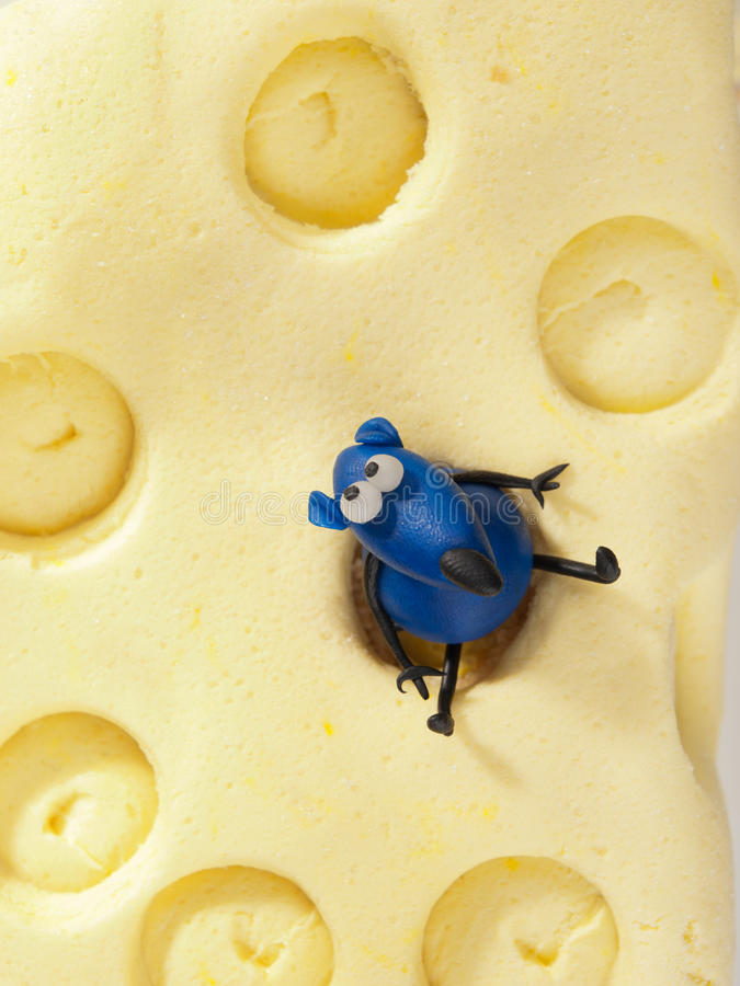 Mouse on cheese fondant cake. Shot from above royalty free stock photos