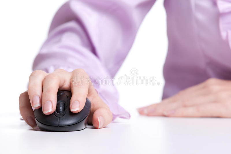 Mouse click. Woman click on wireless mouse royalty free stock photography