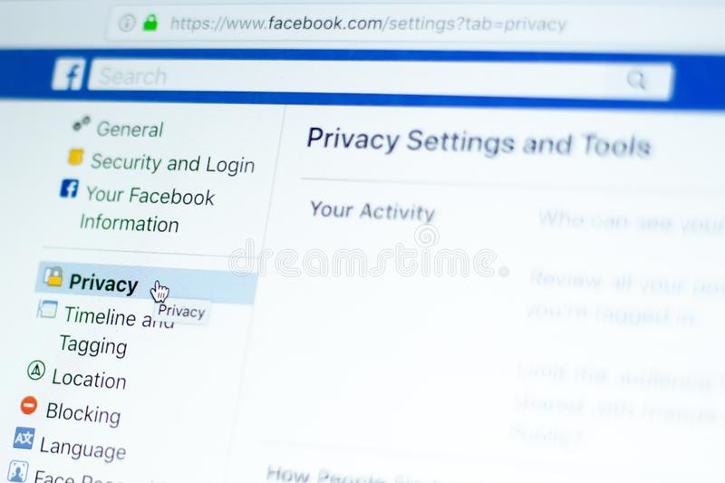 Mouse over Facebook privacy settings. Milan, Italy - January 2, 2019: User moves and hovers the mouse pointer over the privacy settings tab on a Facebook page royalty free stock images
