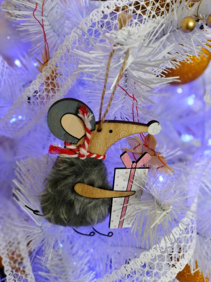 Mouse-shaped on the white Christmas tree stock photos